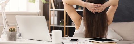 Woman sitting behing the computer with good mood.