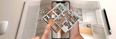 Bild einer Zeitschrift mit dem Plan einer Wohnung, die durch eine Augmented Print Applikation zum Leben erweckt wird