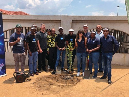Representatives from Konica Minolta SA, FTFA and Mr France Mphele, sharing a sense of excitement following the planting of a tree outside the former home of Nelson Mandela in Orlando East