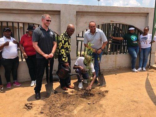 Chris Wild, Executive Director FTFA, Mr France Mphele, current owner of Nelson Mandela's former family home, Mr Lebo Mphele, son of France Mphele, Marc Pillay, CEO Konica Minolta SA, planting a tree outside the home where Nelson Mandela formerly resided.